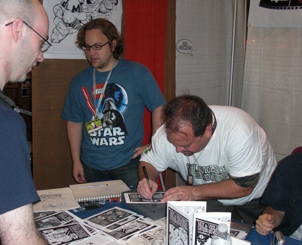 """Draake signing an issue at the """"Bootcamp Comics"""" booth @ FanExpo Toronto 2008"""