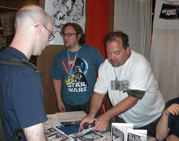 "Draake signing an issue at the ""Bootcamp Comics"" booth @ FanExpo Toronto 2008"